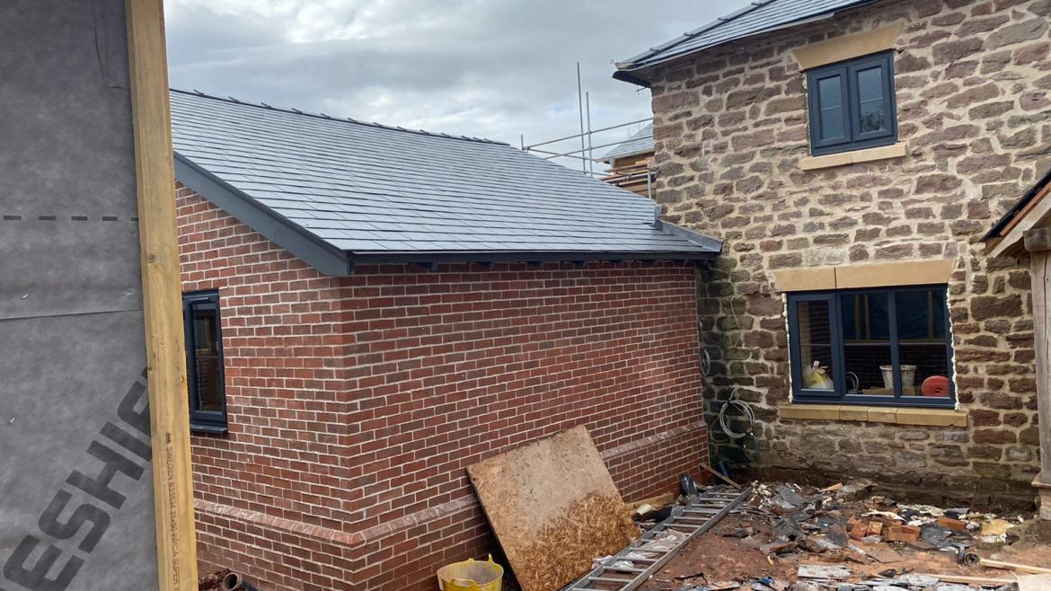 Slate Roofing with Wooden Fascia